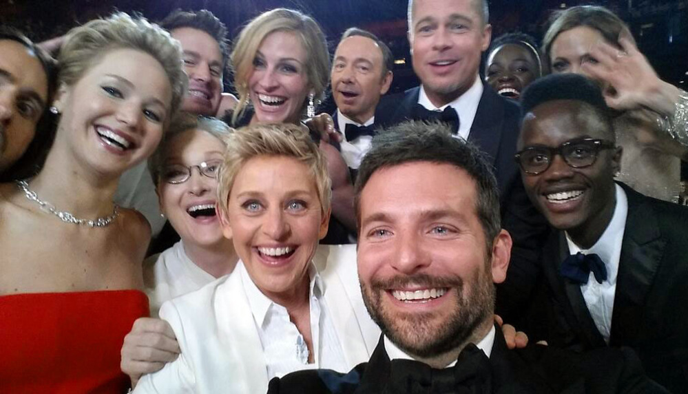 This image released by Ellen DeGeneres shows actors, front row from left, Jennifer Lawrence, Meryl Streep, Ellen DeGeneres, Bradley Cooper and Peter Nyongío Jr.