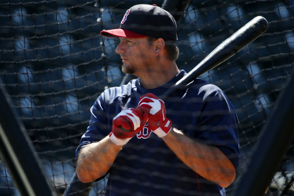 Boston Red Sox's A.J. Pierzynski takes his turn in the batting cage before an exhibition spring training baseball game against the Pittsburgh Pirates in Bradenton, Fla., Monday, March 3, 2014. (AP Photo/Gene J. Puskar)