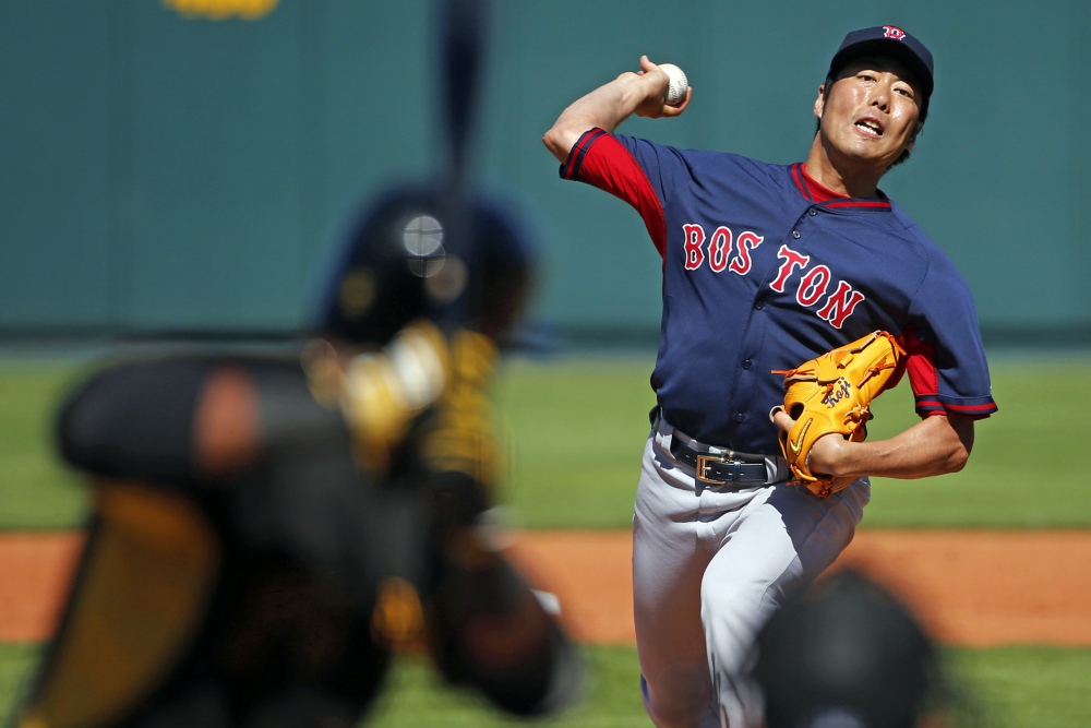 Boston Red Sox pitcher Koji Uehara throws during the fourth inning of an exhibition spring training baseball game between the Pittsburgh Pirates and the Red Sox in Bradenton, Fla., on Monday.