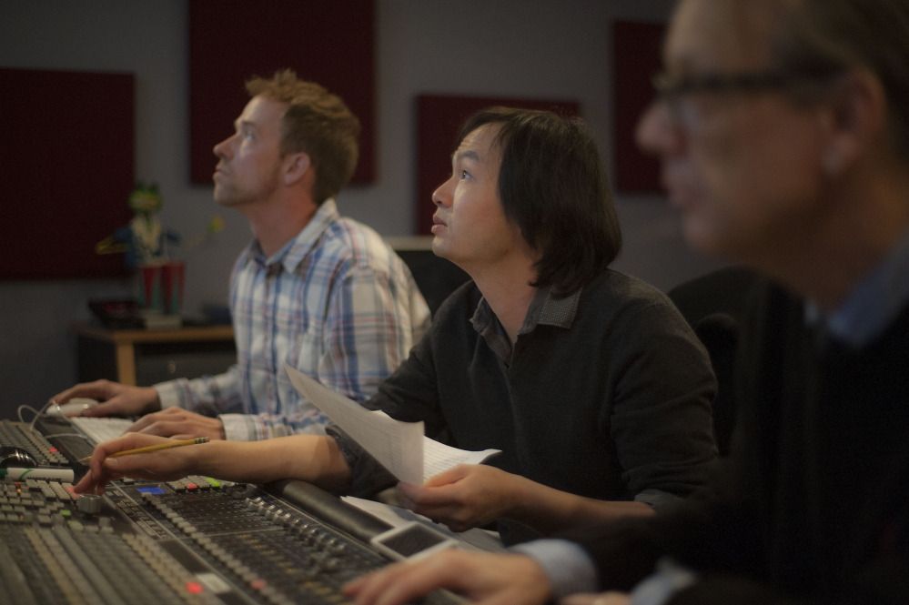 Grammy-winning composer Christopher Tin monitors the audio recording of Anonymous 4 at a New England School of Communications studio.