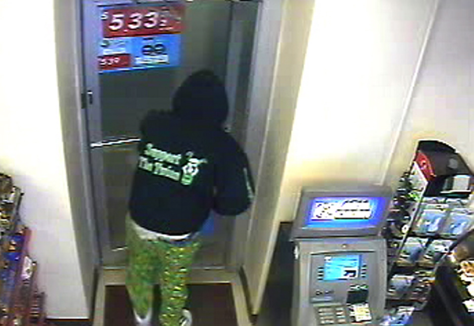 """A security camera photo shows the """"Support the Twins"""" lettering on the back of the robber's hooded sweatshirt."""