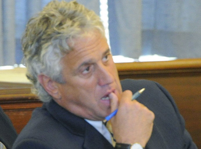 Saco lawyer Gary Prolman said he had no idea that a former client may have been involved in drug smuggling and abruptly broke off his business relations with him after he was first arrested .