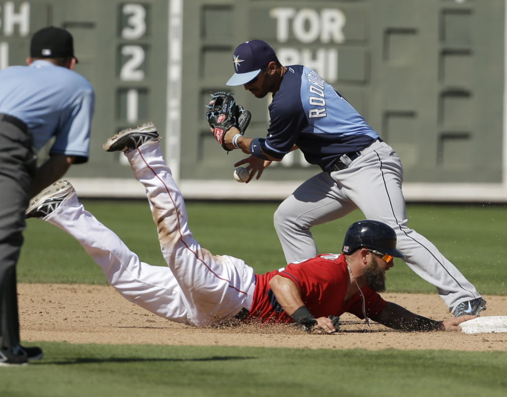 Sean Rodriguez of the Tampa Bay Rays is unable to tag Boston's Mike Napoli, who returns to second base after Xander Bogaerts grounded out in Tuesday's exhibition game at Fort Myers, Fla. Tampa Bay won, 8-0.