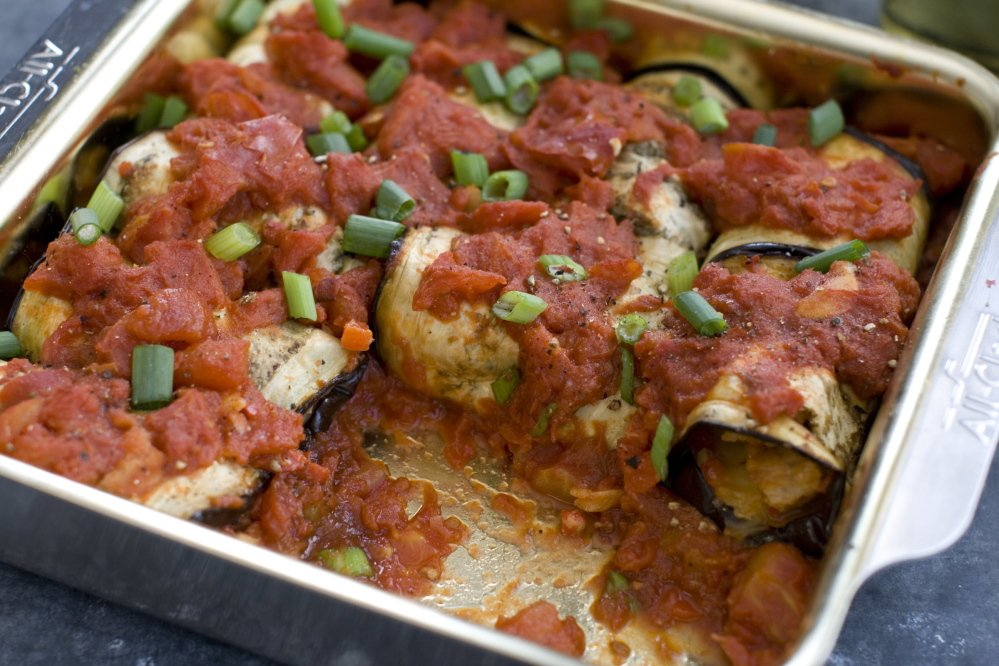 Inside Out Eggplant Parmesan Rolls with speedy marinara sauce makes an excellent centerpiece for a meatless meal.
