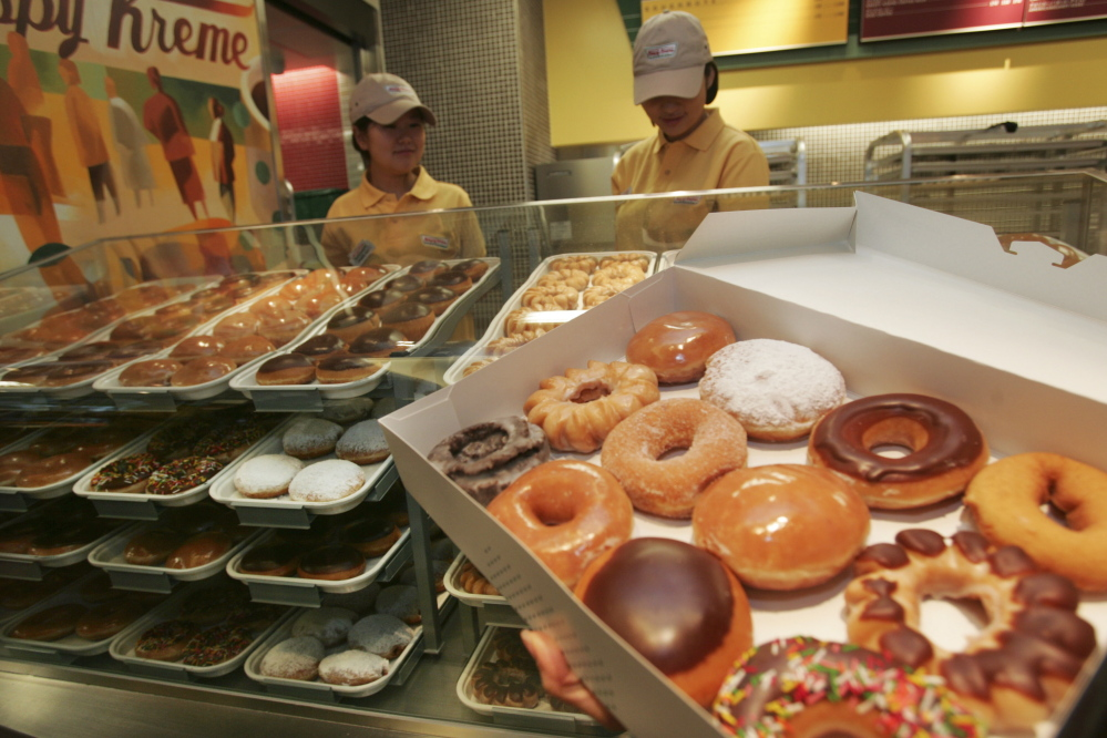 Doughnuts displayed at the Krispy Kreme store in Tokyo. The World Health Organization's revised guidelines say sugar should be just 5 percent of daily total calories.