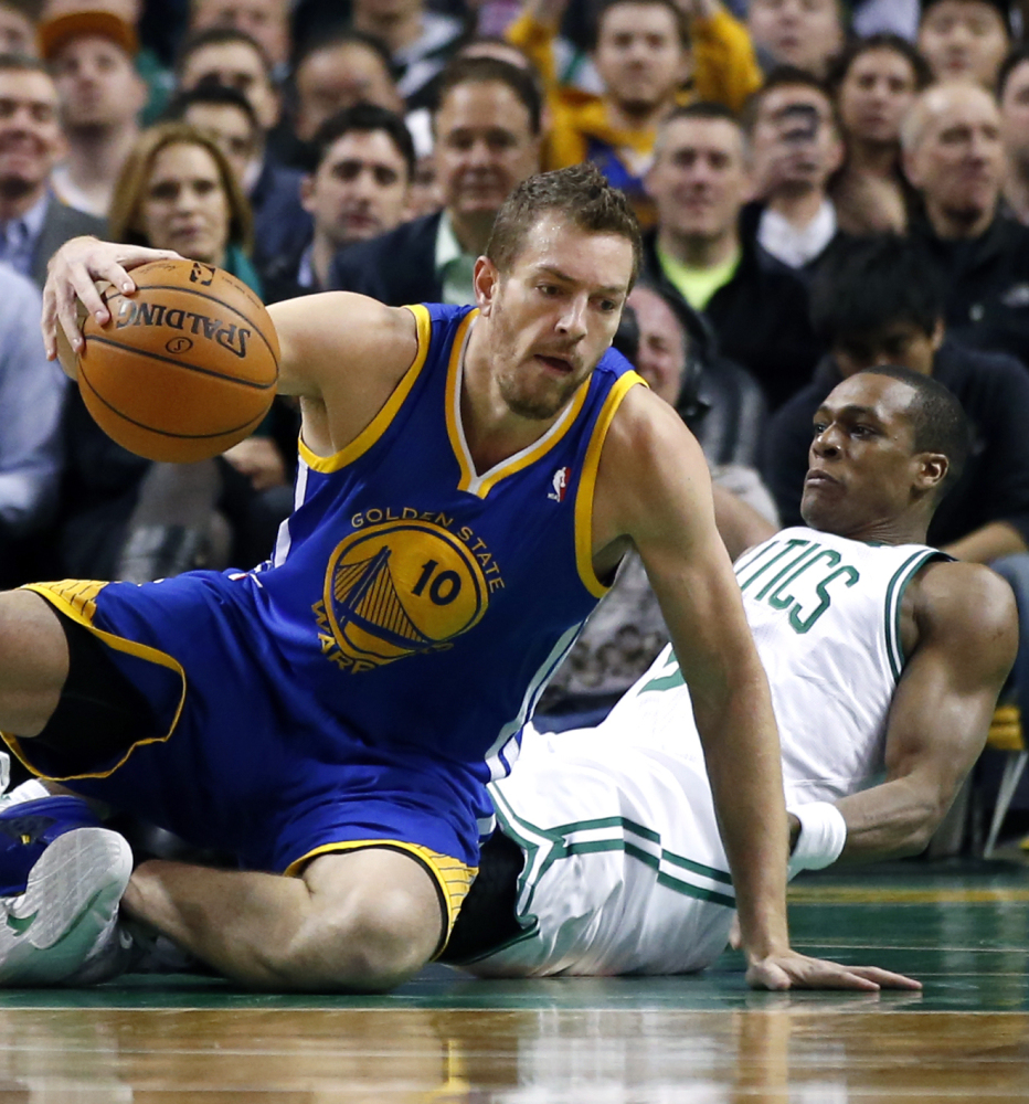 David Lee of the Golden State Warriors controls the ball while colliding with Rajon Rondo of the Boston Celtics during Golden State's 108-88 victory Wednesday night.