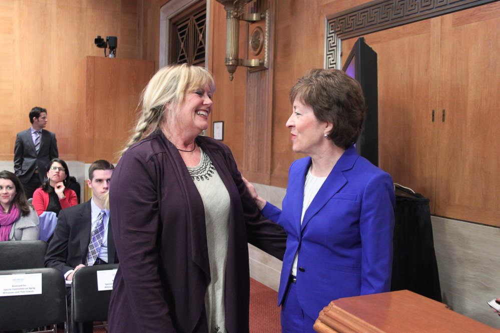 Maine Sen. Susan Collins, at right, speaks with Dixie Shaw of Catholic Charities Maine on Wednesday afternoon before a hearing on elder poverty in the Senate Special Committee on Aging. Shaw runs Catholic Charities' Hunger and Relief Services program in Aroostook County.
