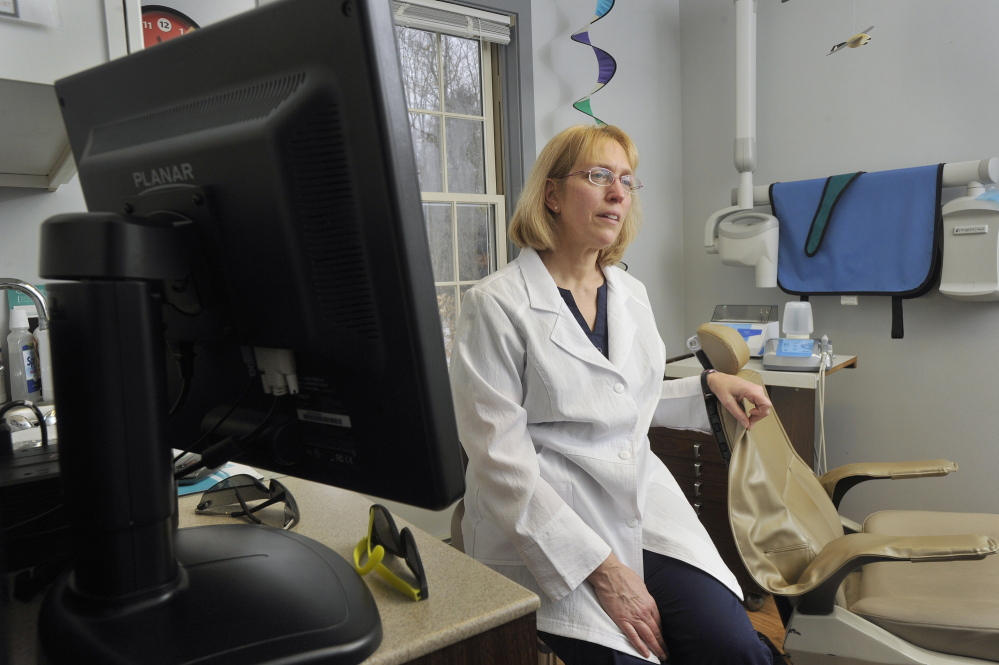 Cathy Kasprak, a dental hygienist who owns her own practice in Bridgton, wants to become a dental therapist. A bill that would allow dental therapists to practice in Maine advanced in the Legislature on Thursday.