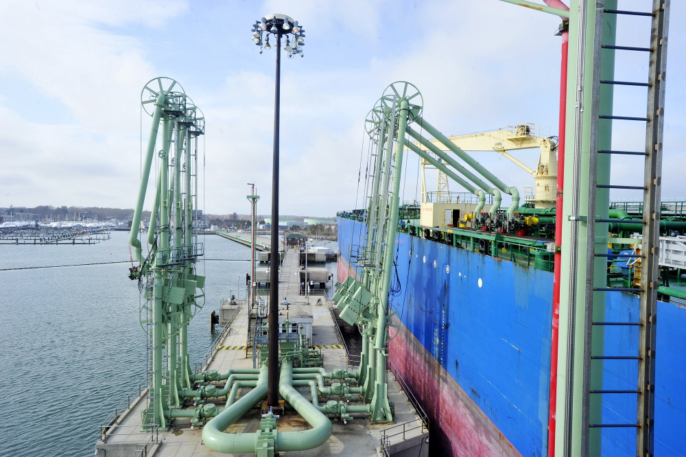 A tanker offloads oil at one of Portland Pipe Line Corp.'s terminals in South Portland. Since the 1940s, the company has pumped oil from the terminals through a 236-mile pipeline that leads to refineries in Montreal.