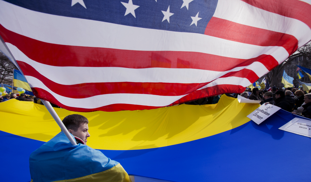 "Roman Pzystach, from western Ukraine, participates in a rally in front of the White House in Washington, Thursday, March 6, 2014, to protest Russian President Vladimir Putin's ""invasion of Ukraine and aggression in the region."" President Barack Obama declared on Thursday that a referendum in 10 days on the future of a Ukraine's Crimea peninsula would violate international law."