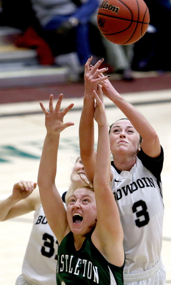 Shannon Brady, right, of Bowdoin attempts to come up with a rebound over Meghan O'Sullivan of Castleton State during their first-round game of the NCAA tournament Friday night.