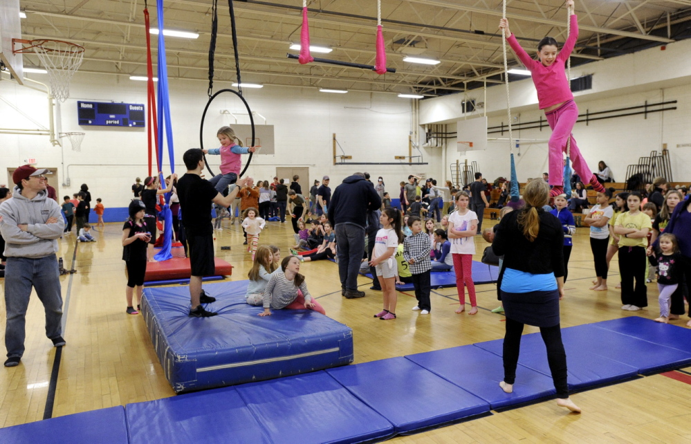 John Patriquin/Staff Photographer Kids are lined up to participate during Circus Atlantic's open house at Reiche Community School in Portland on Saturday.
