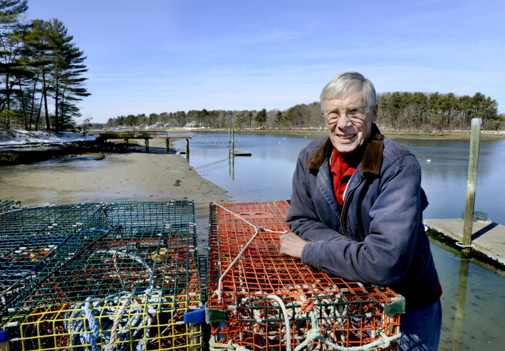 Lobsterman Pat White on his pier along the York River in York is part of a group of residents pushing for studies of the river for a Wild and Scenic Partnership River designation.