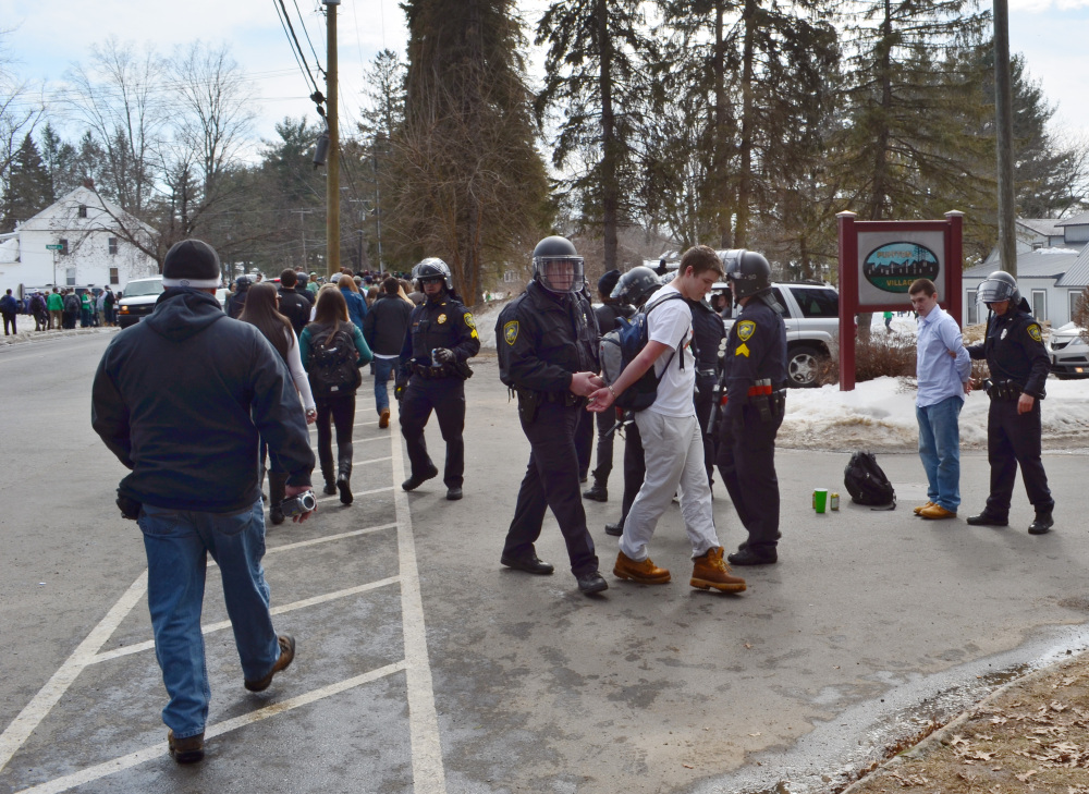 """Police detain revelers in the pre-St. Patrick's Day """"Blarney Blowout"""" near the University of Massachusetts in Amherst, Mass., on Saturday. Police said 73 people were arrested."""