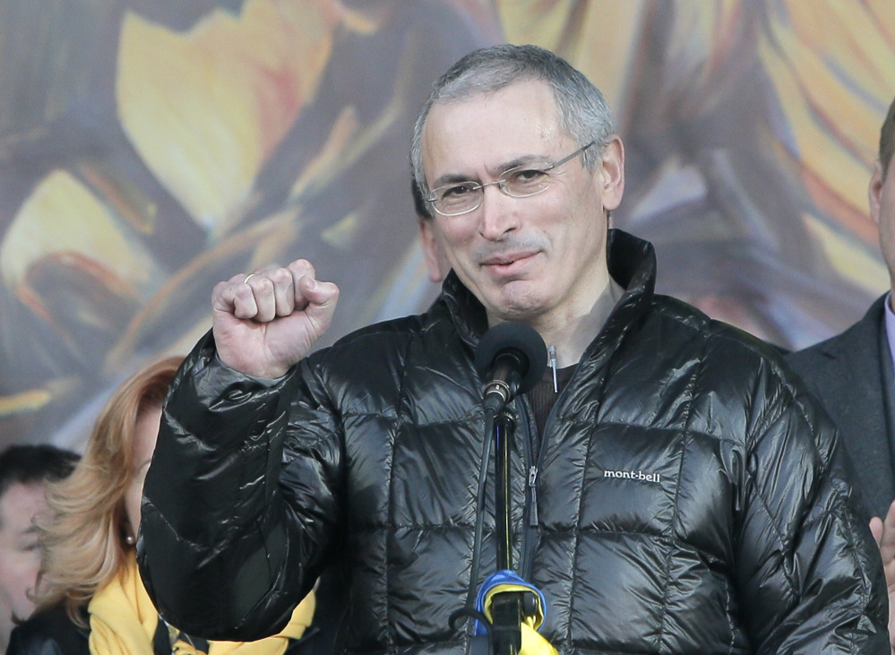 Russian former oil tycoon Mikhail Khodorkovsky cheers people during a rally in the Independence Square in Kiev, Ukraine, Sunday. Khodorkovsky, addressing a crowd on the square where demonstrators rose up against Ukraine's Moscow-backed president, said Russia had been complicit in police violence against the protesters.