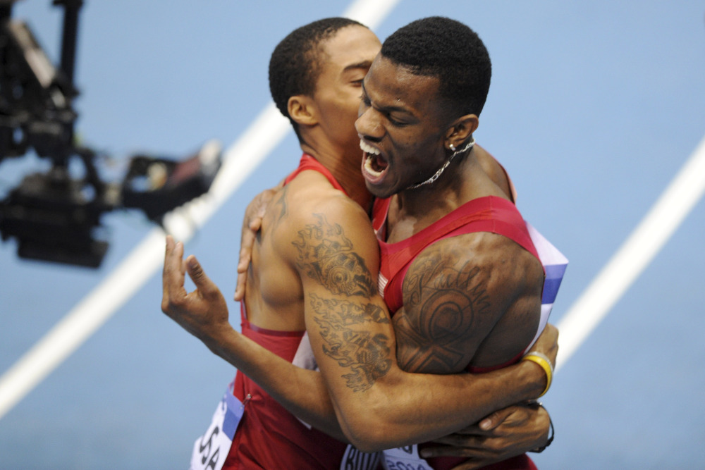 United States' Kyle Clemons, right, and Kind Butler III celebrate winning the gold and setting an indoor world record in the men's 4x400m relay final during the Athletics Indoor World Championships in Sopot, Poland on Sunday.