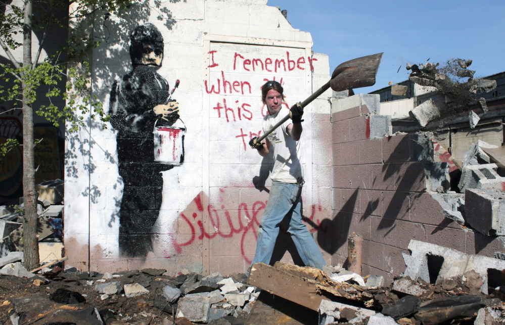 Graffiti art created by Banksy, shown in 2010 in its original location at an abandoned Detroit car plant, will be sold, say officials of 555 Nonprofit Gallery and Studios.