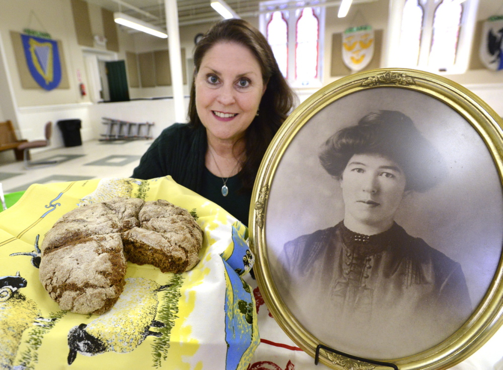 At the Maine Irish Heritage Center in Portland, Ann Marie Chandler displays a brown Irish bread made from a recipe her grandmother used in Ireland and in Portland after she immigrated to the United States in 1910.