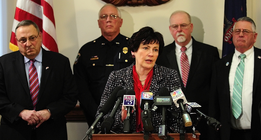 Cumberland County District Attorney Stephanie Anderson speaks during a news conference Tuesday where Gov. Paul LePage, far left, announced his proposal to crack down on drug dealing and drug abuse in the state.