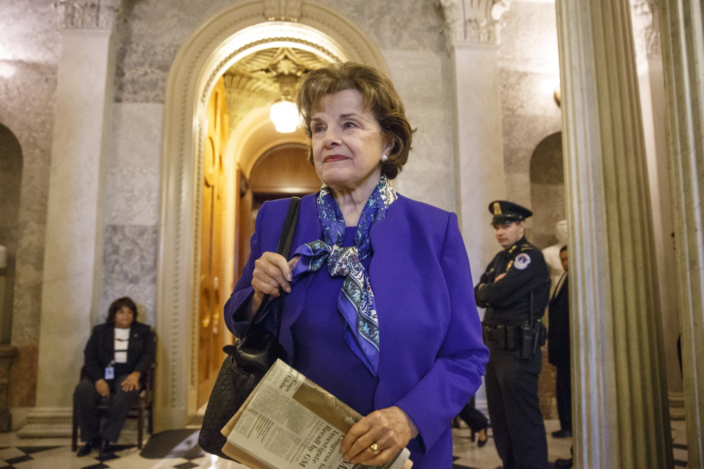 Senate Intelligence Committee Chair Sen. Dianne Feinstein, D-Calif., leaves the Senate chamber on Capitol Hill Tuesday after saying that the CIA's improper search of a stand-alone computer network established for Congress has been referred to the Justice Department.