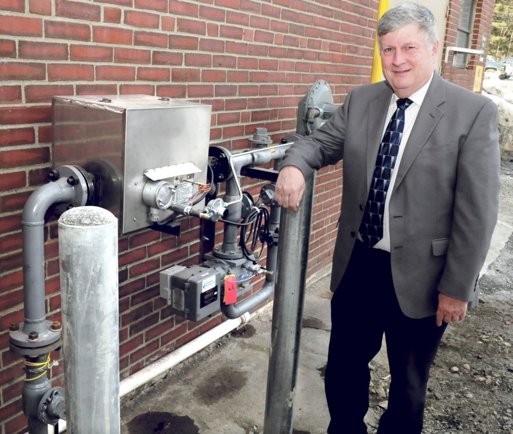 John Dalton, president of Inland Hospital in Waterville, on Monday stands beside a meter where natural gas enters the facility, which has converted to the new energy supply at an estimated annual savings of $100,000.