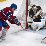 Goalie Tuukka Rask of the Boston Bruins guards the post and prevents a wrap-around shot by Lars Eller of the Montreal Canadiens from getting past him during the first period of the Bruins' 4-1 victory on the road Wednesday night. Boston will be home Thursday night against Phoenix.