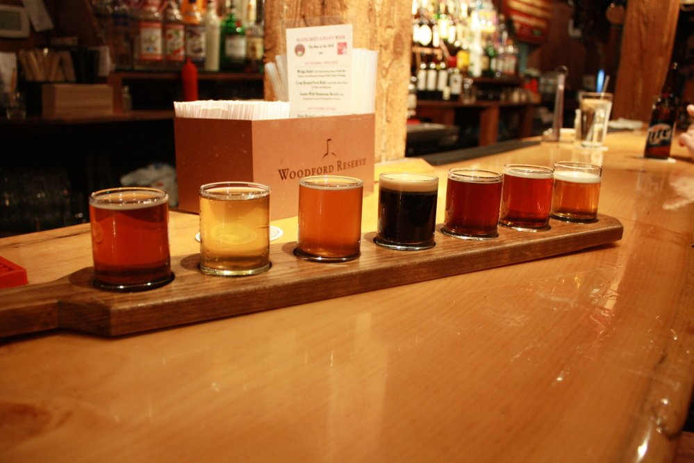 A flight of seven three-ounce pours of Run of the Mill's house made brews for $5.