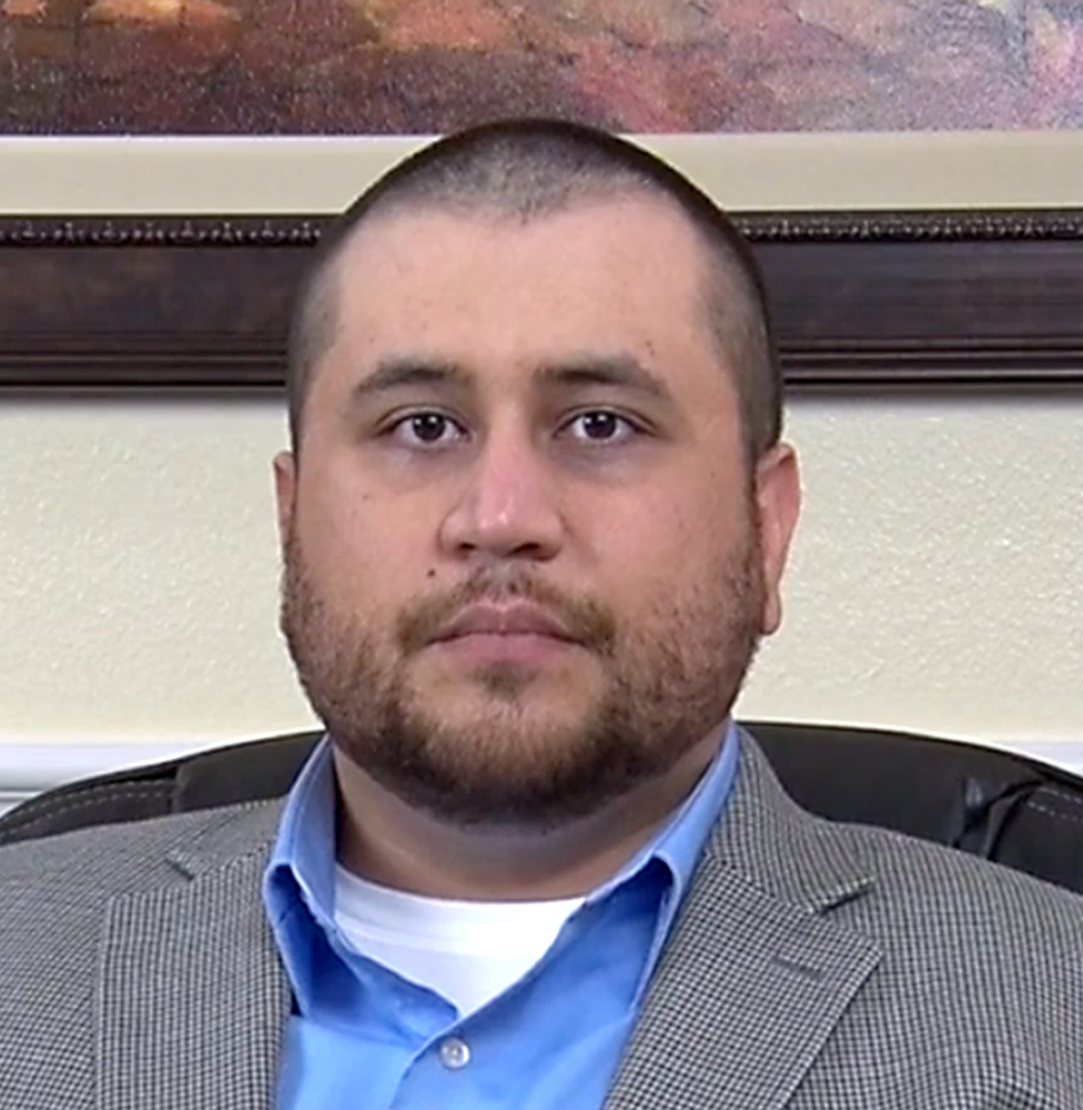 George Zimmerman looks at the video camera while taping an interview with his lawyers on Wednesday.