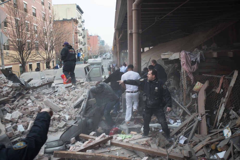 Police respond to the scene of an explosion that leveled two apartment buildings in the East Harlem neighborhood of New York on Wednesday.