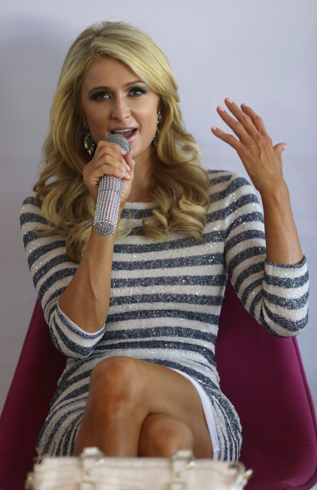 Paris Hilton holds a news conference prior to a ribbon cutting ceremony to unveil the Paris Beach Club.