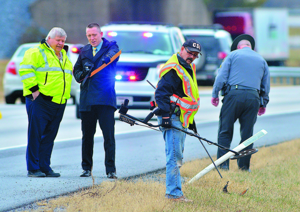 """Franklin County coroner's office staffers and Pennsylvania State Police search Jan. 15 for evidence along Interstate 81 at Exit 3, where a shooting occurred Jan. 4. Timothy """"Asti"""" Davison of Poland, Maine, died after being shot multiple times after his vehicle was run off the road."""