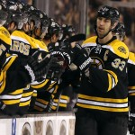 Boston Bruins defenseman Zdeno Chara is congratulated by teammates at the bench after scoring against the Phoenix Coyotes in the first period Thursday.