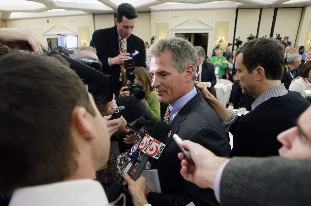 Former Massachusetts Sen. Scott Brown, center, leaves the ballroom at the Republican Leadership Conference after announcing plans to form an exploratory committee to enter New Hampshire's U.S. Senate race against Democratic Sen. Jeanne Shaheen on Friday in Nashua, N.H.