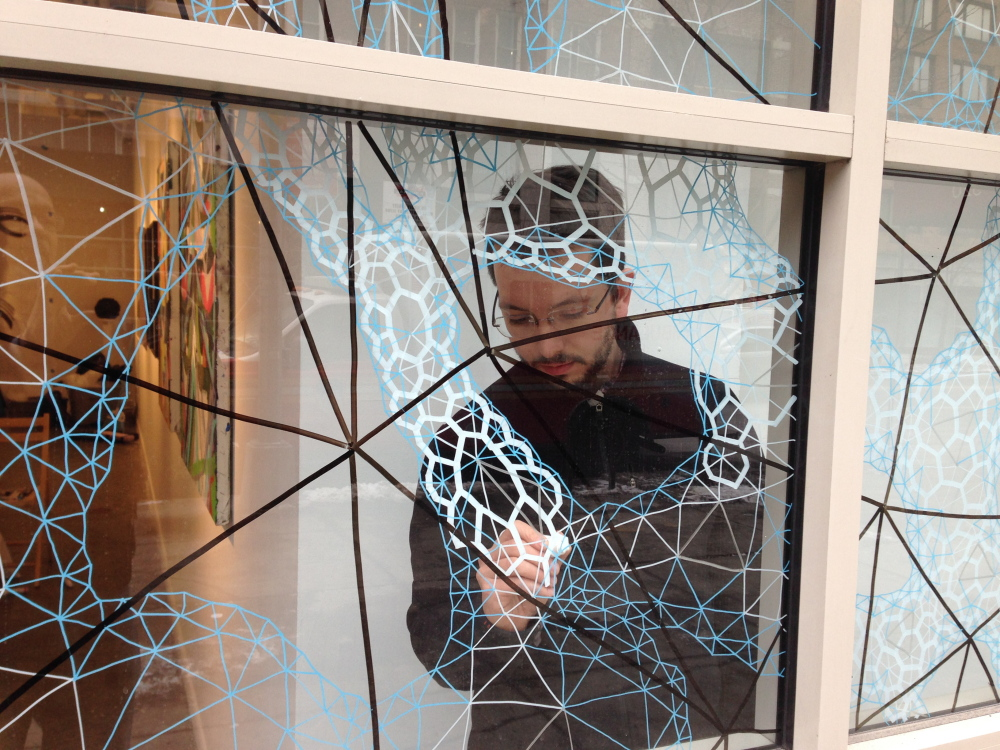 """Clint Fulkerson at work on the installation of """"Second Nature: Abstract Art from Maine"""" prior to its opening this month at the Curator Gallery in New York."""