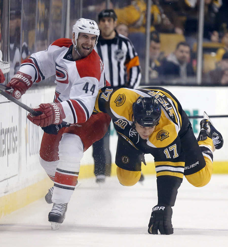Jay Harrison of the Carolina Hurricanes may have sent Milan Lucic of the Boston Bruins sprawling in the first period Saturday, but it was the Bruins who won their eighth straight and sent Carolina sprawling to its eighth loss in 11 games, 5-1.