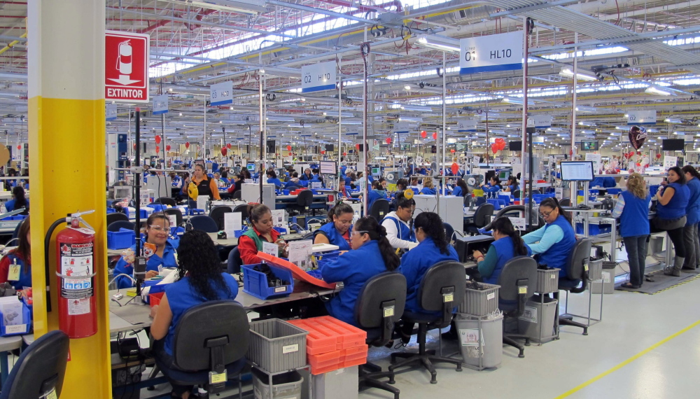 Natural light illuminates the air-conditioned assembly floor at the Plantronics headset plant in Tijuana, Mexico, where occasional theater, dance and music performances enliven the workday. The factory has been named the best place to work in Mexico three years in a row.