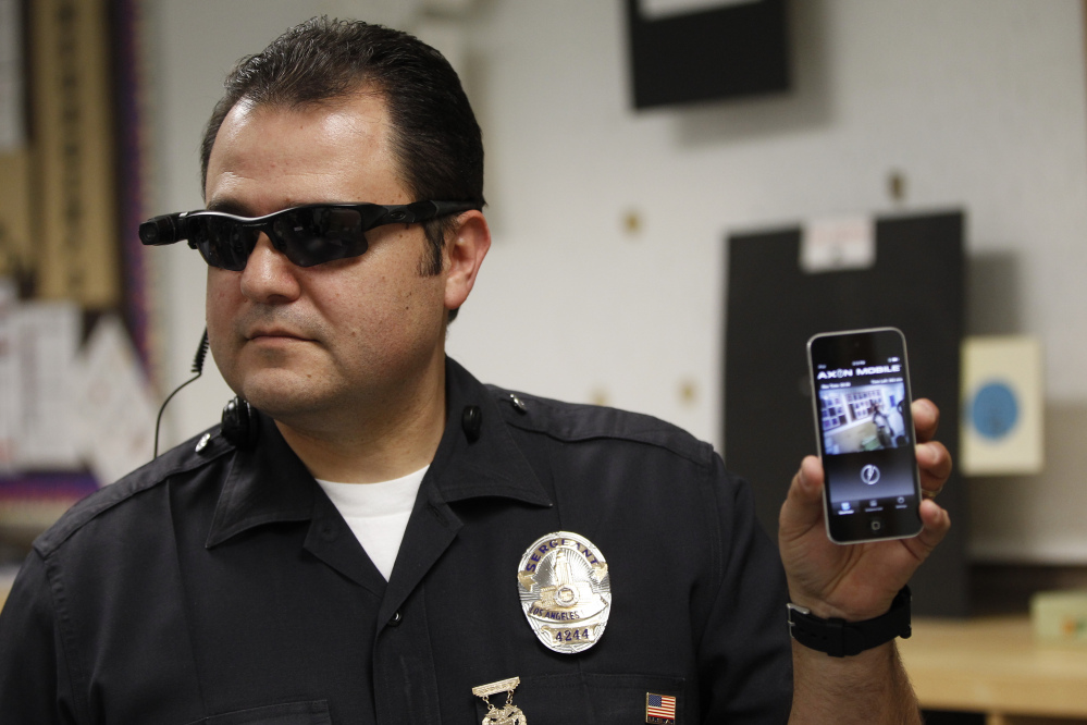 Los Angeles police Sgt. Daniel Gomez shows a video feed from a camera into his cellphone. Without strong policies on body cameras, departments could lose the public's trust.