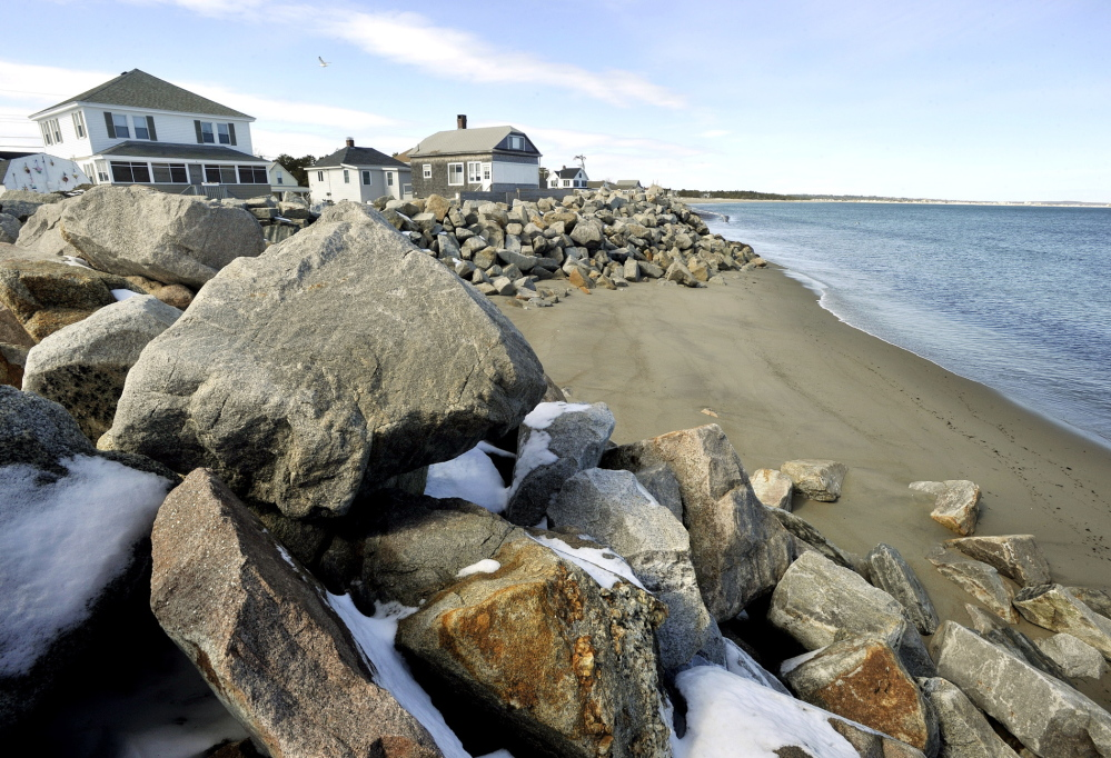 A shield of rocks is one method used to protect houses in Camp Ellis. Nearly 30 houses have been lost to the sea because of erosion.