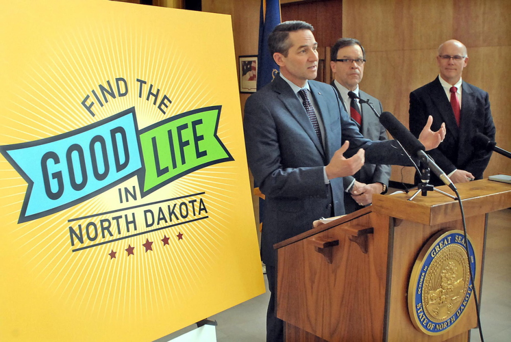 """North Dakota Lt. Gov. Drew Wrigley, left, along with Wally Goulet, center, of the North Dakota Economic Foundation, and Steve McNally, general manager of Hess Corp. in North Dakota, answer questions about the """"Find The Good Life In North Dakota"""" campaign unveiled Monday in Bismarck, N.D."""