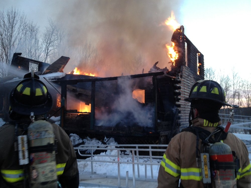 Fire envelopes a home at 38 Mill Road in Randolph on Monday. Resident Richard Messer, who suffered smoke inhalation, was initially taken to MaineGeneral in Augusta, and later transferred to Maine Med in Portland.