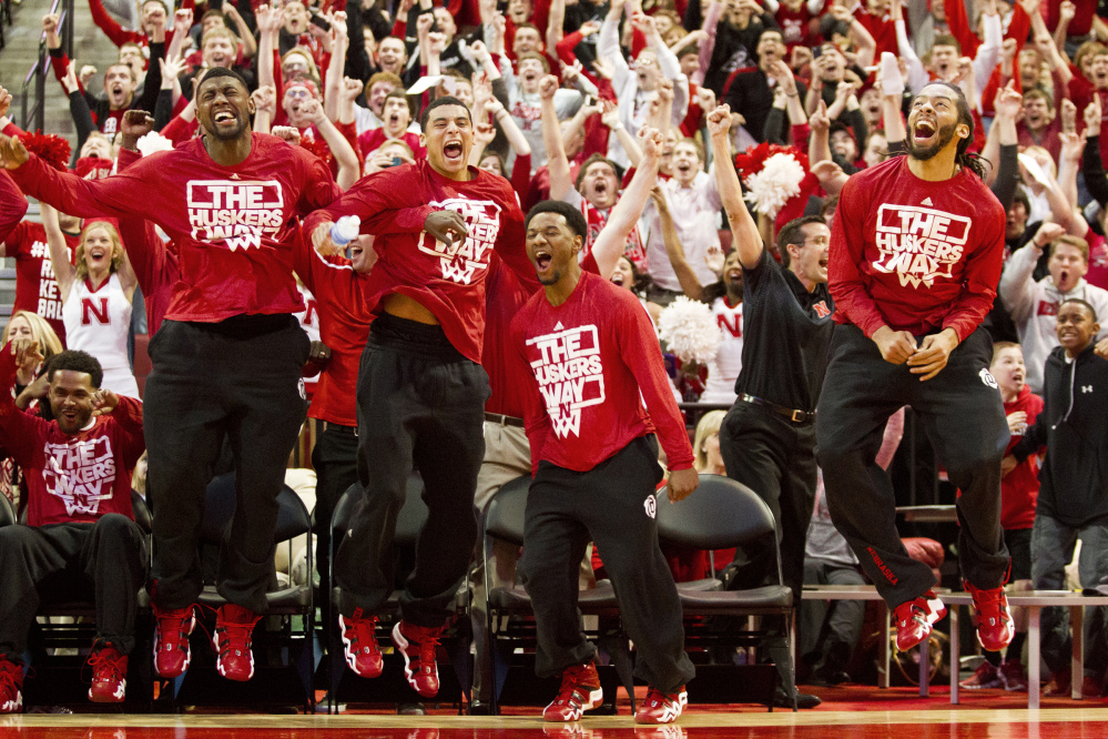 Nebraska players react seconds after the NCAA announced Nebraska's spot in the NCAA tournament bracket Sunday in Lincoln, Neb.
