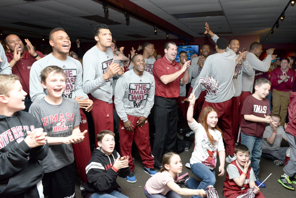 The Associated Press UMass Minutemen and their supporters celebrate their invitation to the NCAA College basketball tournament Sunday at Amherst Brewing Company. UMass will play the winner of Iowa vs Tennessee in the second round of the tournament. A lawsuit filed Monday argues that college athletes should reap some of the financial rewards of such tournament.