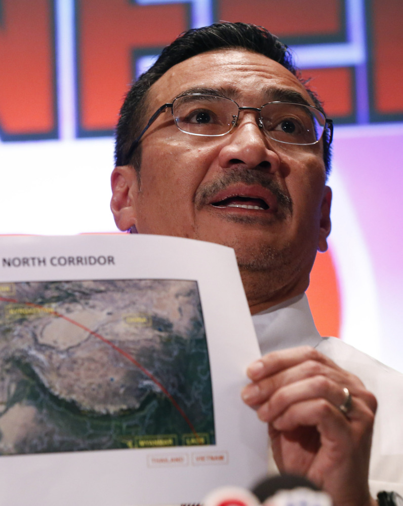 Malaysia's acting Transport Minister Hishamuddin Hussein shows maps of northern search corridor on Monday in Sepang, Malaysia.