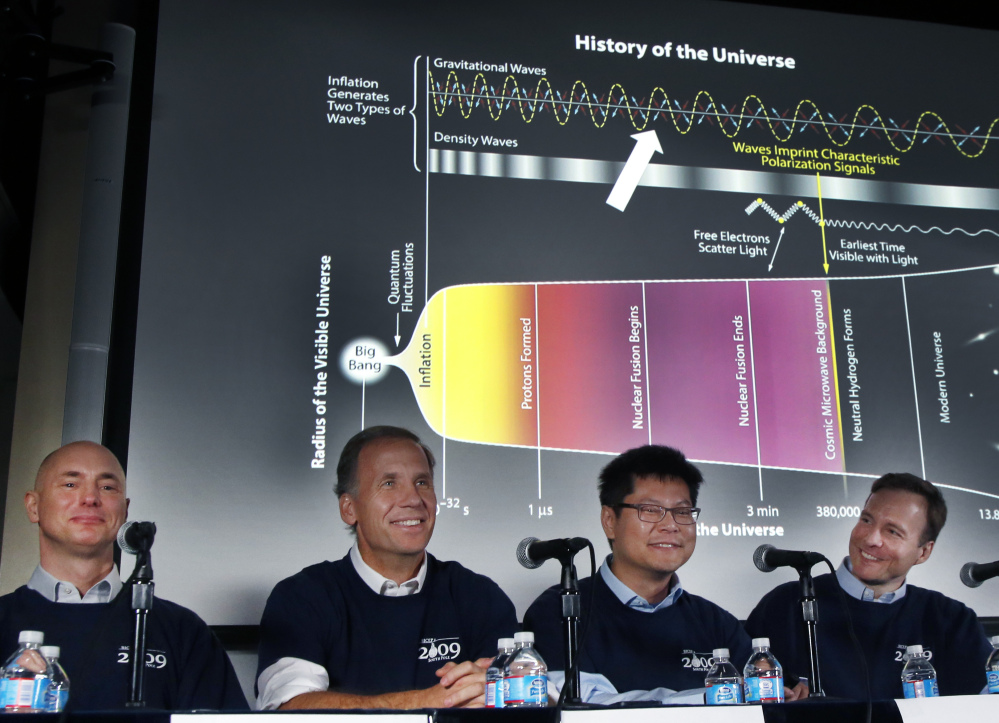 Scientists, from left, Clem Pryke, Jamie Bock, Chao-Lin Kuo and John Kovac hold a news conference at the Harvard-Smithsonian Center for Astrophysics in Cambridge, Mass., on Monday regarding their new findings on the early expansion of the universe.