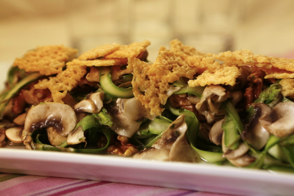 Shaved asparagus with mushrooms and Parmesan crumble is a favorite aspargus-inspired dish.