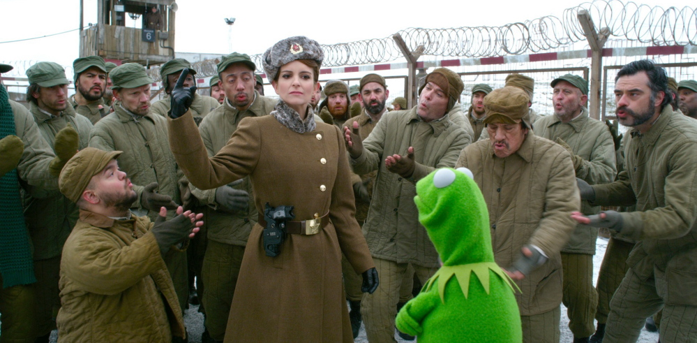 "Tina Fey with Kermit in ""Muppets Most Wanted."""
