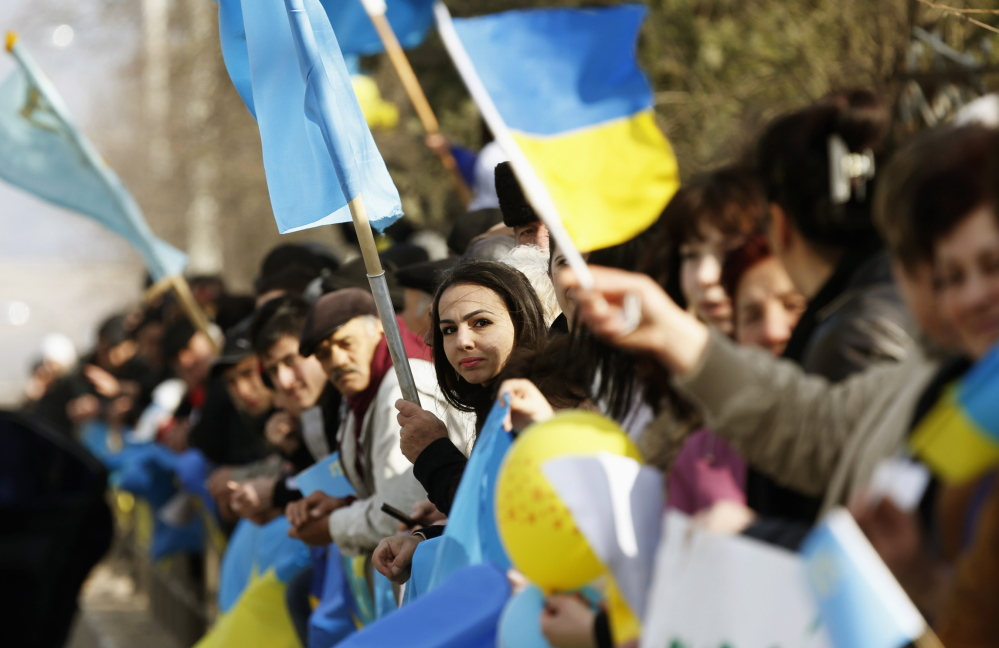 Crimean Tatars take part in a pro-Ukranian demonstration outside Simferopol on Monday. By some counts, members of more than 100 ethnic minorities reside in Crimea.