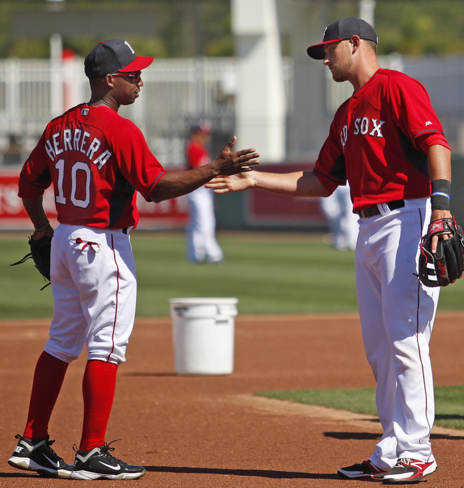 It's not just about pitching, hitting, defense and baserunning. Spring training is a time to work on that handshake. Jonathan Herrera and Will Middlebrooks get in their work.