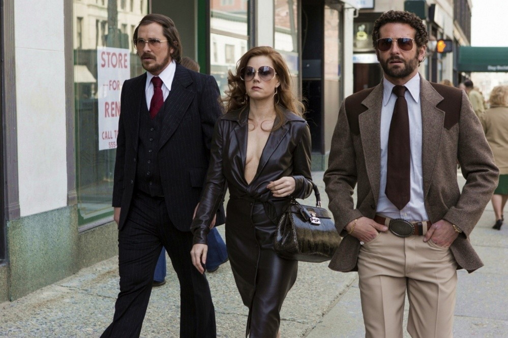 "Christian Bale, Amy Adams and Bradley Cooper in ""American Hustle."""