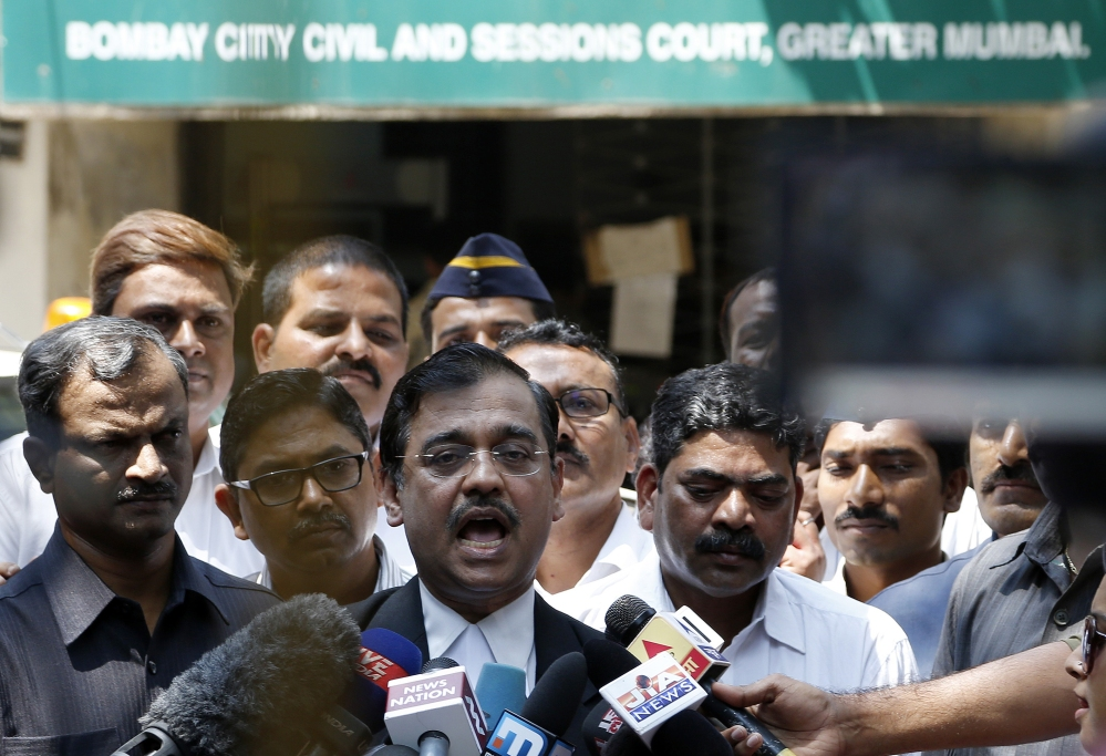Special Public Prosecutor Ujjwal Nikam speaks to the media outside court Thursday after the court convicted four men of raping a photojournalist and a call-center operator last summer inside an abandoned textile mill in the financial hub of Mumbai, India.